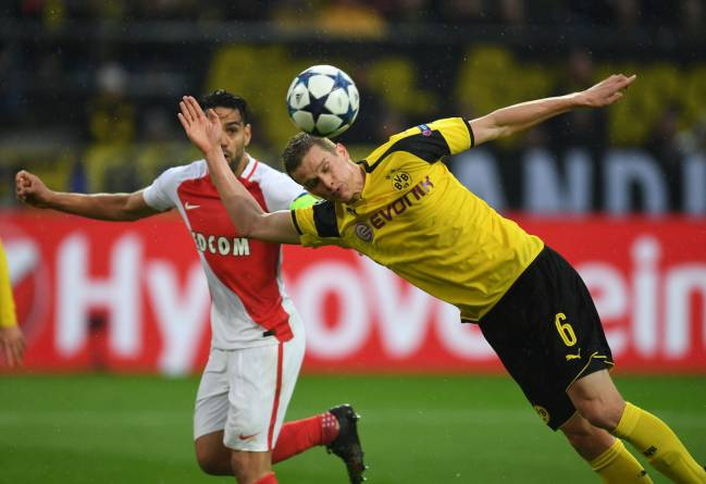 Dortmund's defender Sven Bender heads into his own goal to give Monaco atwo goal lead.