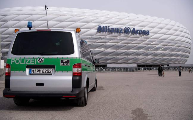 A police car on patrol at the Allianz Arena stadium in Munich this morning.