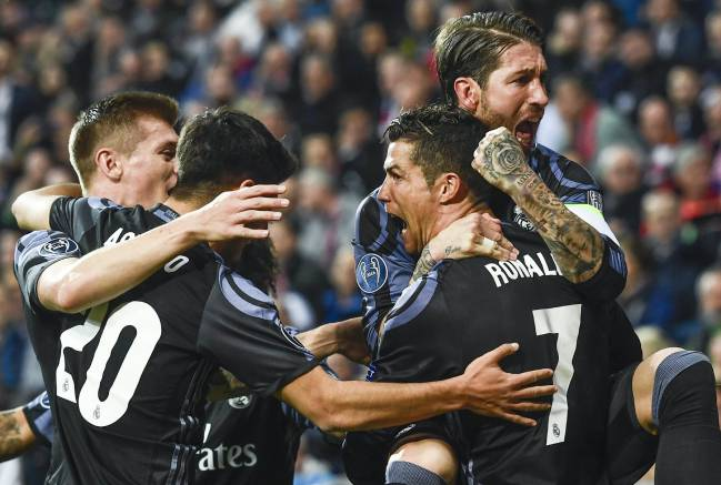 The Real Madrid players delight in Cristiano Ronaldo's goal against Bayern Munich.