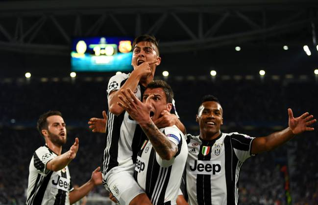 Paulo Dybala celebrates after scoring against Barcelona