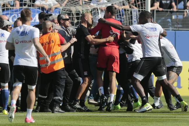 Bastia fans invade the pitch at the Armand Cesari stadium.