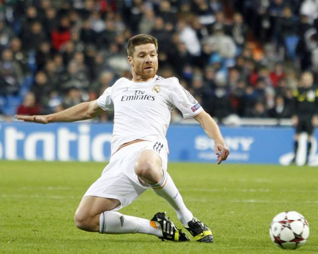 Back in the white of Madrid, Xabi Alonso.