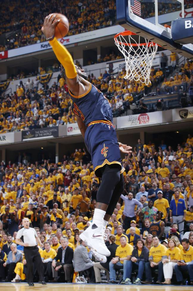 LeBron James of the Cleveland Cavaliers goes in for a dunk in the fourth quarter of Game Five of the Eastern Conference First Round