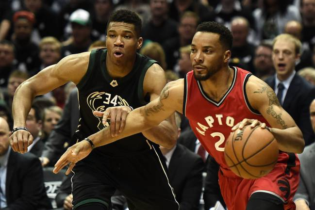 Norman Powell of the Toronto Raptors drives to the basket against Giannis Antetokounmpo of the Milwaukee Bucks