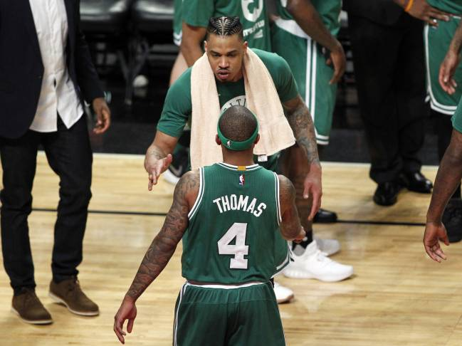 Boston Celtics forward Gerald Green and guard Isaiah Thomas celebrate during the second half in game three of the first round of the 2017 NBA Playoffs
