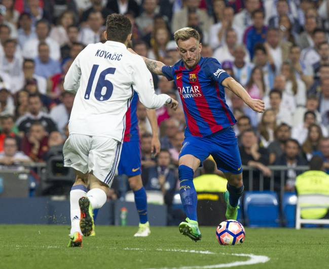 Ivan Rakitic pulls his left foot back before giving Barcelona the lead late on.