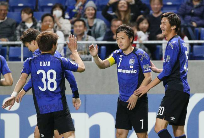 Gamba Osaka midfielder Ritsu Doan celebrates his goal against Adelaide.