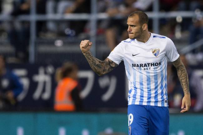 Get in. Sandro, on target against Sevilla.