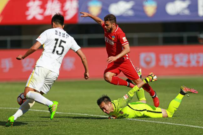 Moraes #9 of Tianjin Quanjian and Sun Jie #15 of Changchun Yatai compete for the ball during the eighth round match of 2017 Chinese Football Association Super League (CSL) on May 6, 201.