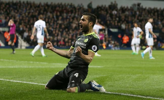 Chelsea's Cesc Fabregas celebrates after teammate Michy Batshuayi scored the 1-0 lead against West Brom.