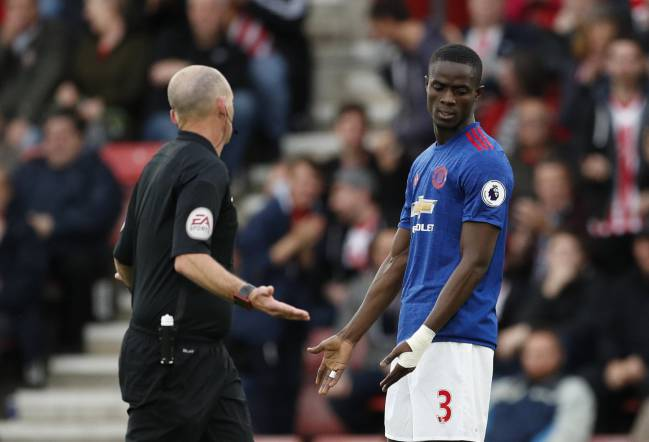 Manchester United's Eric Bailly with referee Mike Dean after he awarded a penalty to Southampton.