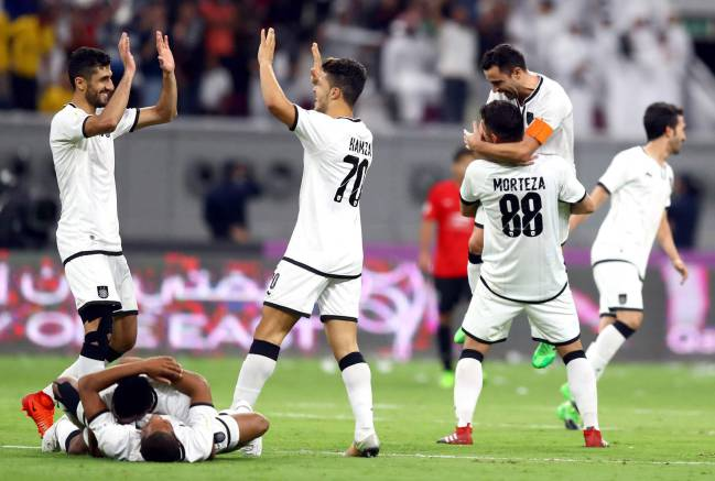 Al-Sadd's players celebrate Emir Cup victory against Al-Rayyan.