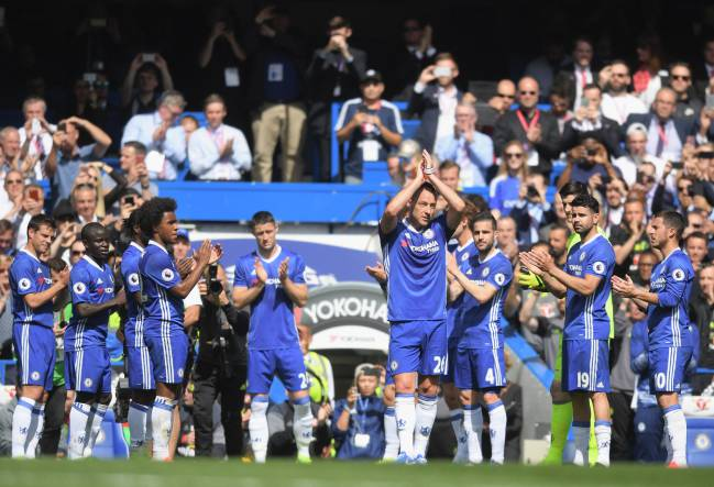 John Terry is given a guard of honour by his team mates as he leaves the pitch at Stamford Bridge.