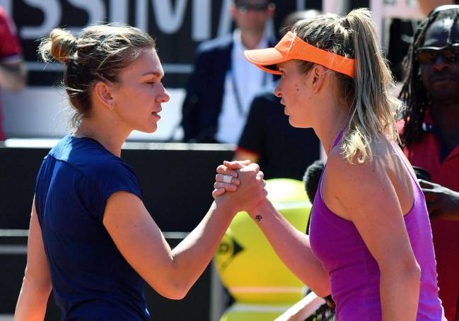 Elina Svitolina of Ukraine shakes hands with Simona Halepof Romania after their women's final of the Italian Open.