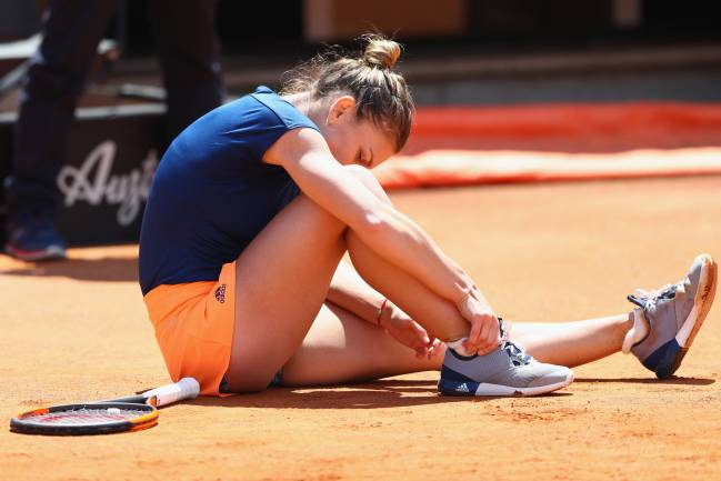 Simona Halep of Romania injures her ankle after slipping during the women's final against Elina Svitolina of Ukraine.