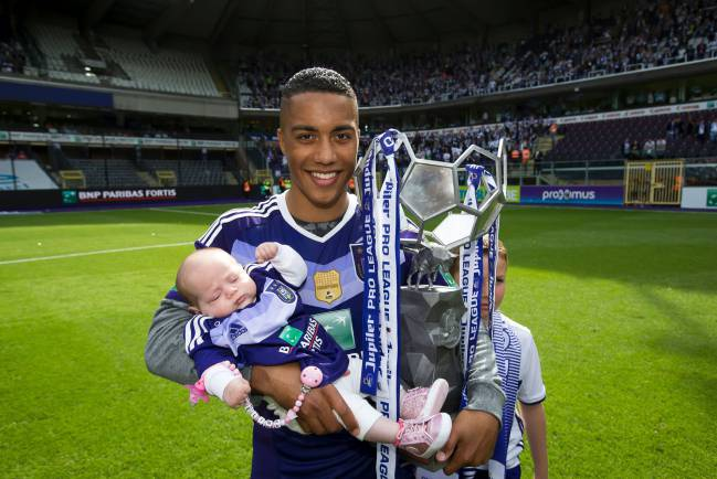 Anderlecht's Youri Tielemans and his daughter Melina pose with the trophy as he celebrates winning Anderlecht's 34th Belgian championship title