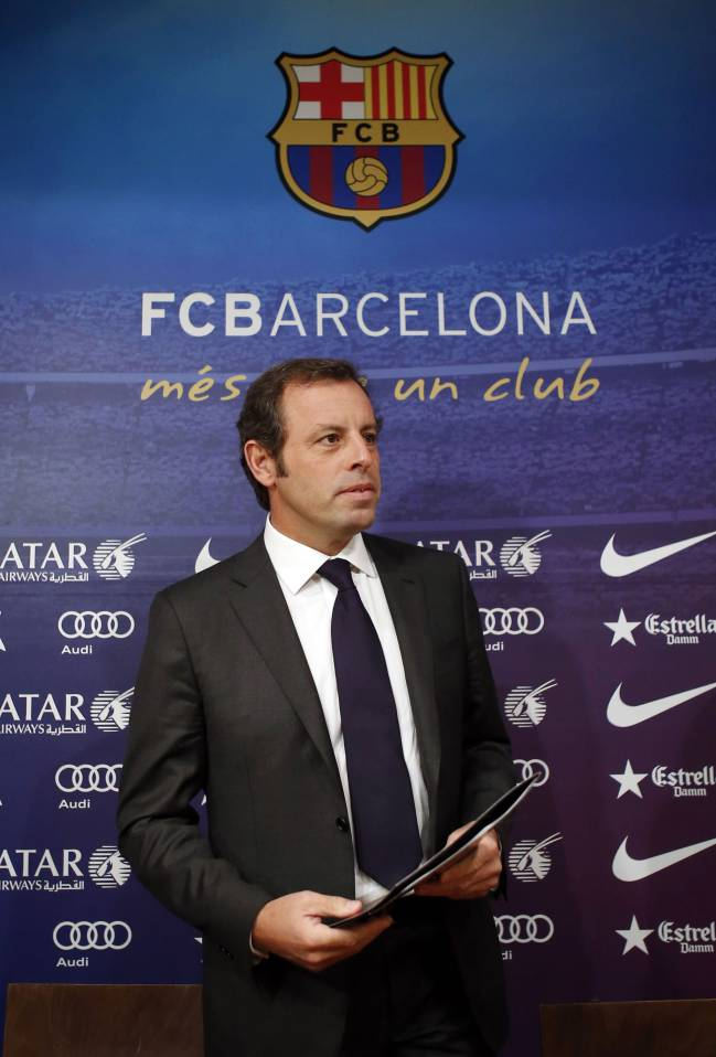 Barcelona president Sandro Rosell arrives for a news conference where he announced his resignation, at Camp Nou stadium in Barcelona