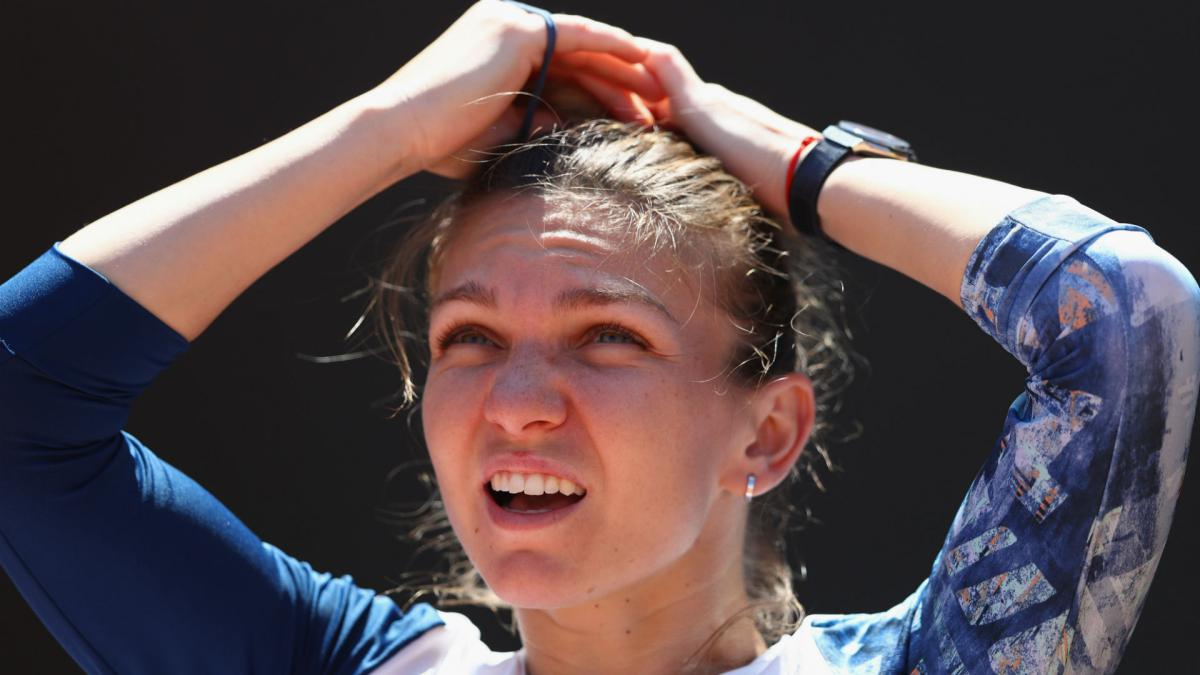 Torn ankle ligament leaves Halep 50-50 for Roland Garros