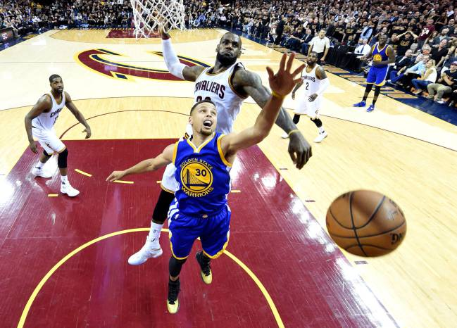 Cleveland Cavaliers forward LeBron James blocks a shot by Golden State Warriors guard Stephen Curry during the fourth quarter in game six of the NBA Finals