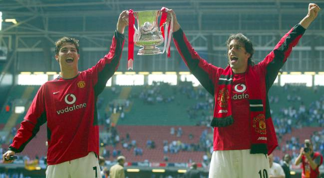 Cardiff memories | Manchester United's goalscorers Cristiano Ronaldo and Ruud van Nistelrooy hold the FA Cup.