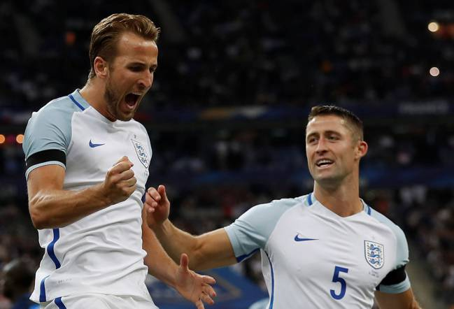 Ten-man France swept England aside at the Stade de France, with goals from Umtiti, Sidibé, and Dembélé as Varane saw red. Kane scored twice for England.