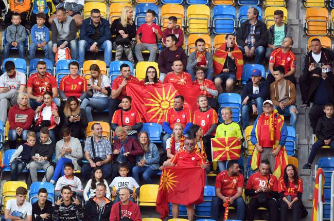 Macedonia's fans attend the UEFA U-21 European Championship Group B football match Spain.