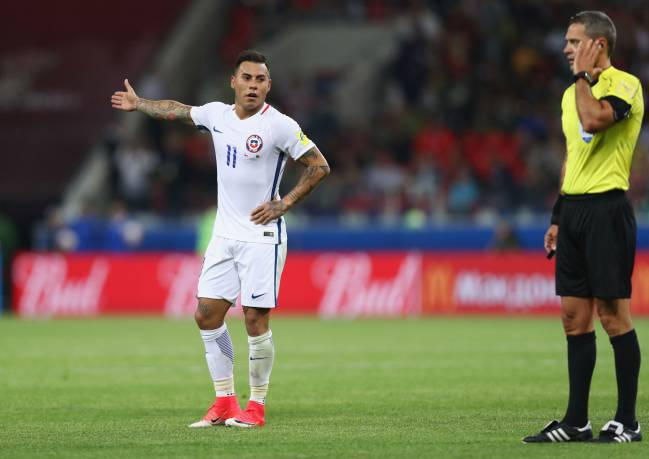 Eduardo Vargas of Chile appeals as referee Damir Skomina listens to his ear piece during the FIFA Confederations Cup Russia 2017