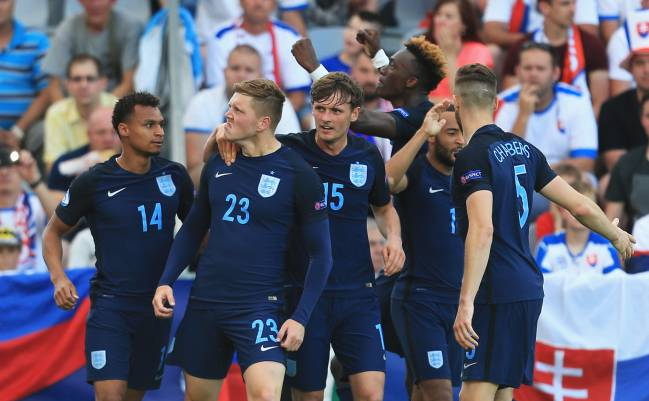 Alfie Mawson of England celebrates scoring his team's first goal against Slovakia.
