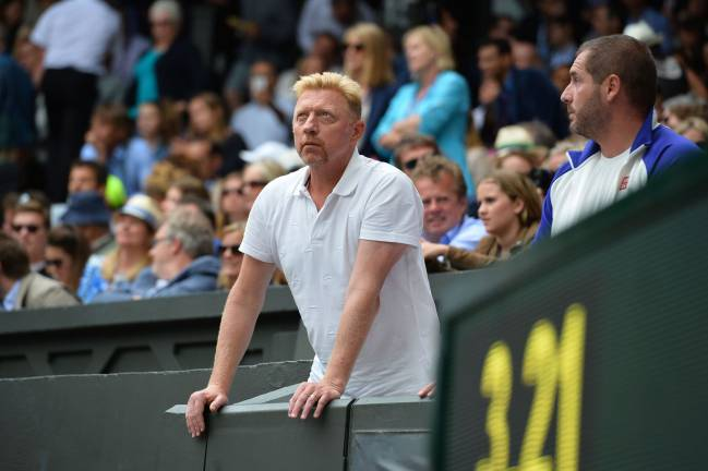 July 12, 2015 German tennis coach Boris Becker standing in the players box on Wimbledon's Centre Court as he watches the men's singles final match between Serbia's Novak Djokovic and Switzerland's Roger Federer.