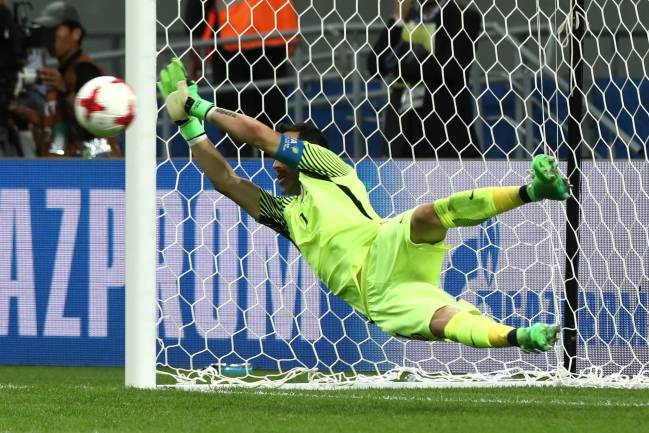 Claudio Bravo of Chile saves a penalty in a shootout during the FIFA Confederations Cup Russia 2017 Semi-Final match between Portugal and Chile