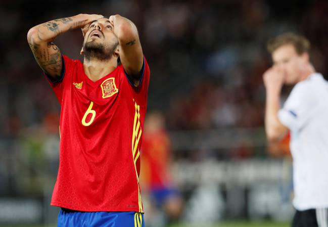 Spain's Dani Ceballos reacts.