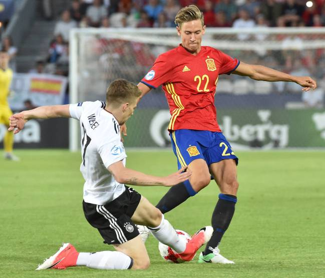 Marcos Llorenteof Spain in action against Mitchell Weiser of Germany.