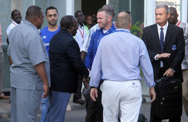 Wayne Rooney meets Tanzanian sports officials at Julius Nyerere International Airport.