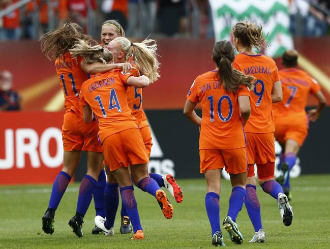 Dutch players celebrate the victory against Norway after the UEFA Women's EURO 2017 opening game.