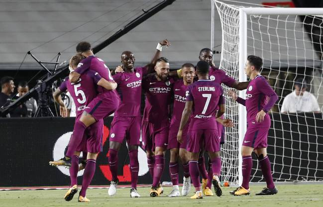 City celebrate their opening goal against Madrid.