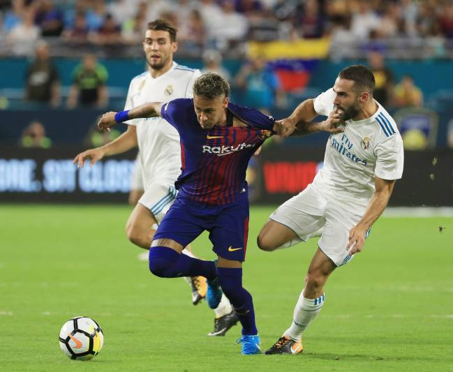 Neymar and Carvajal vie for the ball during their International Champions Cup 2017 match at Hard Rock Stadium on July 29, 2017.