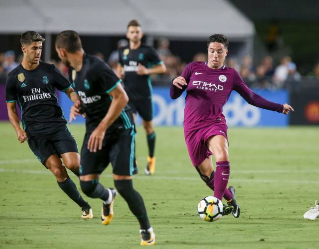 Manchester City midfielder Samir Nasri drives on against Real Madrid during the second half of the International Champions Cup.