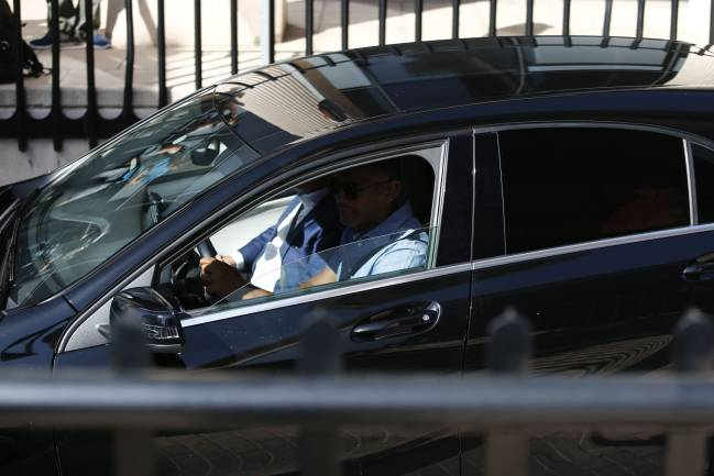 Real Madrid's Portuguese forward Cristiano Ronaldo arrives in a vehicle with tinted windows to appear at a court.