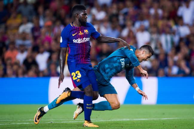 Cristiano Ronaldo booked after going down too easily in the eyes of referee against Samuel Umtiti.