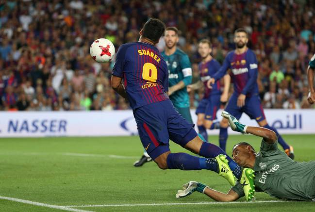 Barcelona's Luis Suarez is judged to have been brought down by Real Madrid's Keylor Navas for a penalty.