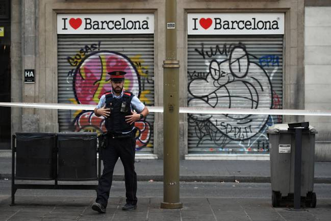 A police officer patrols on Las Ramblas following yesterday's terrorist attack, on August 18, 2017.