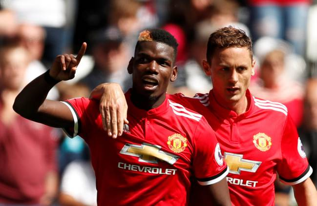 Manchester United's Paul Pogba celebrates scoring their third goal with Nemanja Matic