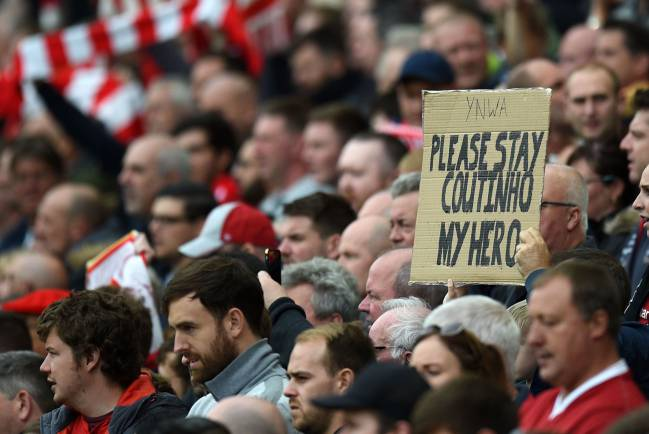 A fan holds up a placard in support of Liverpool's Brazilian midfielder Philippe Coutinho.