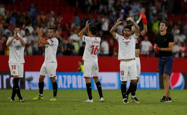 Sevilla's players applaud the fans at the end of the match