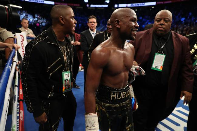Floyd Mayweather Jr. celebrates after his TKO of Conor McGregor in their super welterweight boxing match