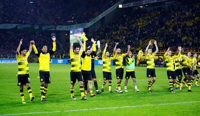 Borussia Dortmund players celebrate after the 5-0 thrashing.