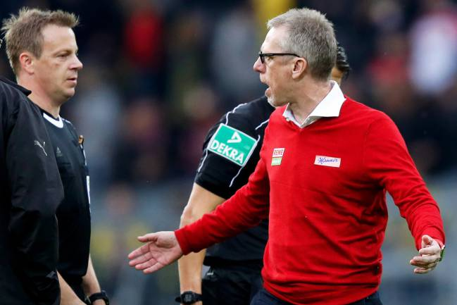 Cologne's head coach Peter Stoeger argues with a linesman during the German Bundesliga match against Borussia Dortmund.