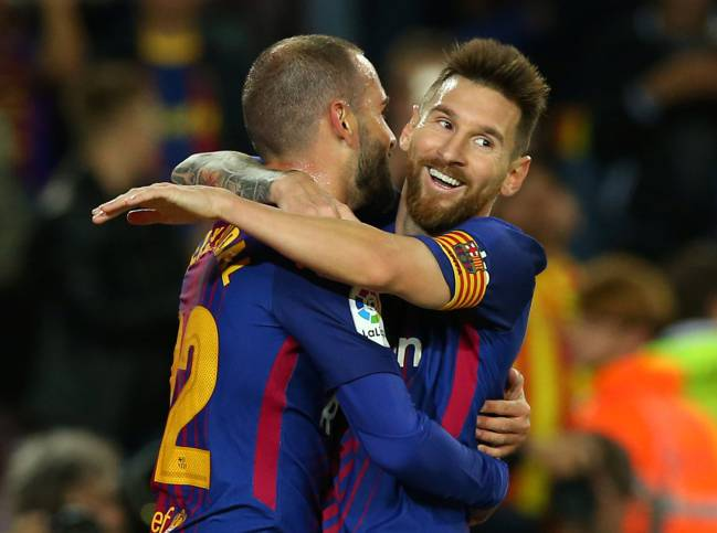 Messi celebrates with Aleix Vidal after Barcelona's sixth.