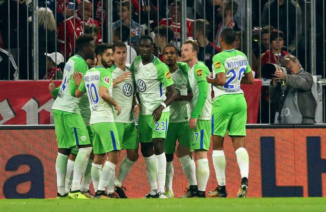 Wolfsburg's Daniel Didavi celebrates scoring their second goal with team mates.