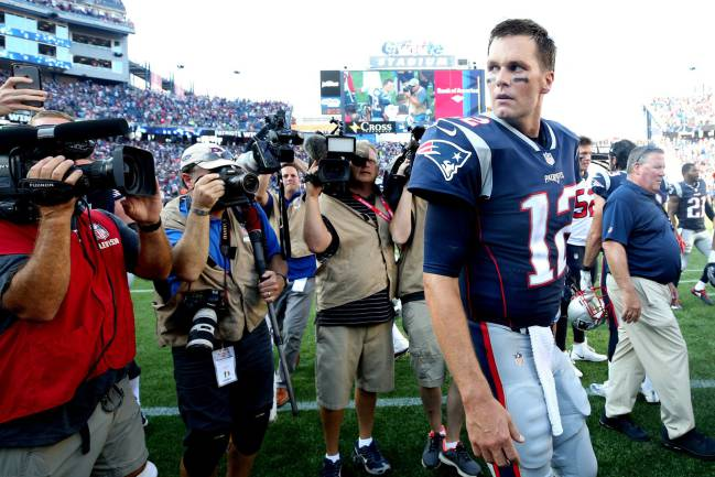 Tom Brady of the New England Patriots looks on after the Patriots defeat the Houston Texans 36-33